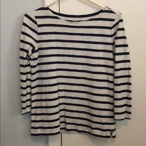 Navy blue and white striped long sleeve shirt.